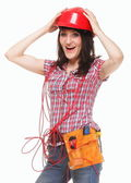 Woman in helmet with entangled red cable — Stock Photo