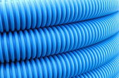 Blue hose plastic pipe — Stock Photo