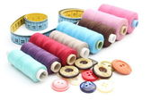 Colorful spools of thread, tape measure and buttons — Foto Stock
