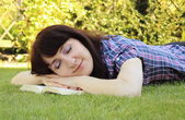 Sleeping woman after reading a book — Stock Photo
