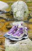 Hiking boots over a mountain stream — Стоковое фото