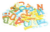 Old, colorful, plastic letters on white background — Stock Photo
