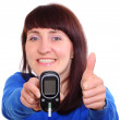 Smiling woman with glucose meter showing thumbs up — Stock Photo