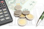 Heap of coins, paper money, calculator and pen on spreadsheet — Foto Stock