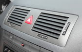Car emergency button and air conditioning system elements — Stock Photo