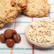 Oatmeal cookies with ingredients lying on colored background — Stock Photo #49490295