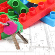 Home keys and colorful building blocks on housing plan — Stock Photo