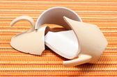 Broken mug, shattered cup on orange cloth — Stock Photo