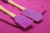 Closeup of purple silicone kitchen accessories — Stock Photo