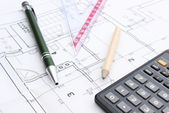 Drawing accesories and calculator on housing plan — Stock Photo