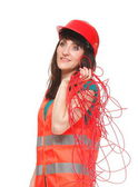 Builder woman in reflective vest with red cable — Stock Photo