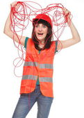 Builder woman in reflective vest and entangled red cable — Stock Photo
