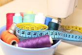 Colorful spools of thread, tape measure and thimble — Стоковое фото