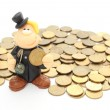 Chimney sweep on a pile of coins. Isolated on white — Stock Photo #50195535