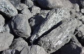 Stack of large and black coal lumps prepared for winter — Stock Photo