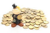 Chimney sweep on a pile of coins. Isolated on white — Stock Photo