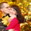 Portrait of young man kissing his girlfriend — Stock Photo #50422469