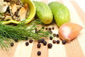 Green cucumbers and spices for pickling — Stock Photo