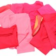 Heap of red and pink clothes with womanly shoes — Stock Photo #51252195