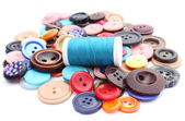 Blue thread with needle and collection of colored sewing buttons — Stock Photo