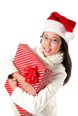 Joyful Girl Hugging Christmas Present — Stock Photo
