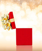 Red Gift Box on Glittering Background — Stock Photo