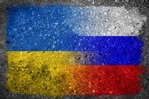 Merged Russian and Ukrainian Flags Painted on Concrete Wall — Stock Photo