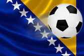 Soccer Ball Streaks Across Bosnia's Flag — Foto de Stock