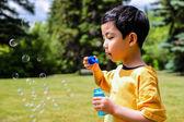 Boy Blowing Bubbles — Stock Photo