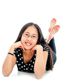 Cute Tween Lying on Floor in Casual Pose — Stock Photo