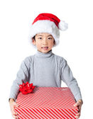 Cute Boy Holding Christmas Present — Stock Photo