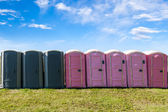 Outdoor Portable Toilets on an Open Field — Stock Photo