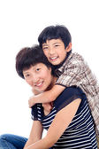 Boy hugs mom affectionately. — Stock Photo