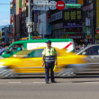 Постер, плакат: Warden Directs Peak Hour Traffic in Tapei