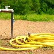 Water tap with garden hose — Stock Photo #49472477