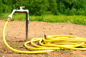 Water tap with garden hose — Stock Photo