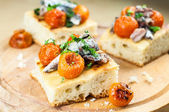 Delicious focaccia with sardines and cherry tomatoes — Stock Photo