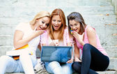 Happy young college girls — Stock Photo