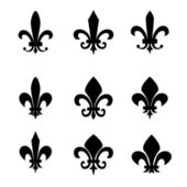 Collection of fleur de lis symbols - black silhouettes — Stock Vector