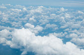 Fluffy white clouds and blue sky background — Foto de Stock
