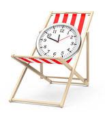 Clock on a beach chair — Stock Photo