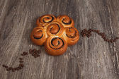 Spiral bun with granules of coffee — Stock Photo