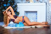 Lying bikini girl with boxes of gifts — Stock Photo