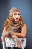 Girl in a winter hat and mitten — Stock Photo