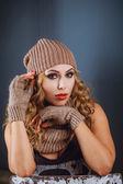 Portrait of a girl in a winter hat and mitten — Stock Photo