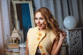 Blond girl in beige waiscoat — Foto Stock