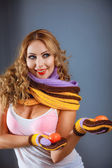 Blond girl in striped scarf and mitten — Stock Photo