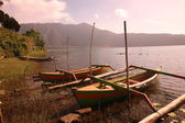 Fishing boat on sunset on Batur lake — Foto Stock