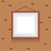 Vector frame for paintings or photographs on the brick wall background. — Stockvector