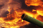 Cannon under cloudy red sky — Stock Photo